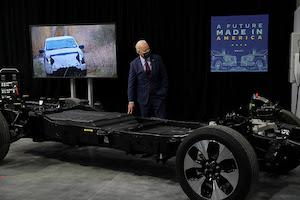 President Joe Biden by electric car